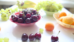 Different Summer fruits on a table stock video footage