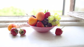 Different Summer fruits on a window sill Stock Photos