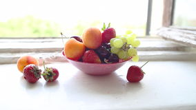 Different Summer fruits on a window sill stock video footage