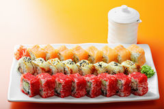 Different sushi rolls and saucer Stock Images