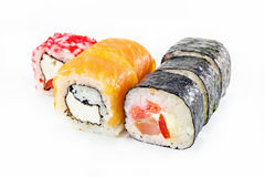 Different sushi rolls on white background. Different sushi rolls with chopsticks on white background stock photo