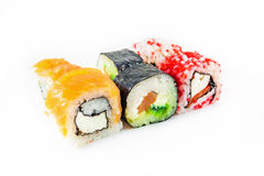 Different sushi rolls on white background. Different sushi rolls with chopsticks on white background stock image