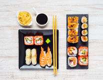 Different Sushi Types with Soy Sauce and Gari Stock Photos