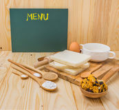 Different sweet baking  and cereals on a table with blank board Royalty Free Stock Images