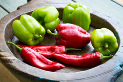Different sweet bell peppers. Different sweet peppers on wooden plate Stock Photo
