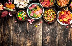 Different sweet candy, jelly, marshmallows and candied fruits. Royalty Free Stock Images