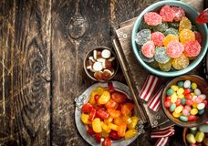 Different sweet candy, jelly, marshmallows and candied fruits. Stock Photography