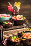 Different sweet candy, jelly, marshmallows and candied fruits. Stock Image