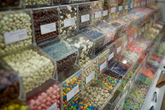 Different sweets in boxes at candy shop Stock Photos