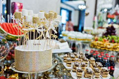 Different swets and cup cakes at wedding reception.  stock image