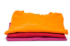Different T-Shirts in orange, red and purple Stock Image