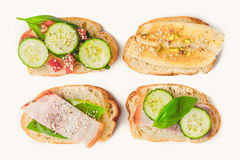 Different tartines on the white background top view Royalty Free Stock Photography