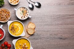 Free Different Tasty Cream Soups And Bread On Wooden Table, Flat Lay. Space For Text Royalty Free Stock Images - 214767829