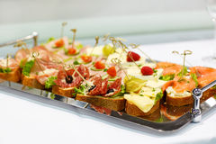 Different tasty snacks on luxury banquet table Royalty Free Stock Photos