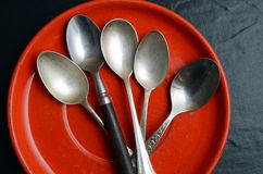 Different teaspoons on a plate Royalty Free Stock Photos