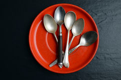 Different teaspoons on a plate Royalty Free Stock Images