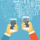 Different techno icons flows into modern smartphones Stock Image