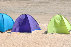 Different tent. Tent in different color on sand, shown as seaside enjoy in summer and holiday life Royalty Free Stock Images