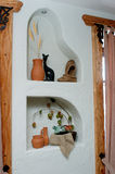 Different things in a niche. Fragment of an interior with different things in a niche Royalty Free Stock Photography