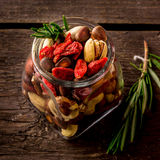 Different tipes of nuts in jar. Stock Photos