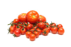 Different tomatoes closeup on a white background Royalty Free Stock Photo