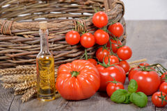Different tomatoes with olive oil Stock Photos
