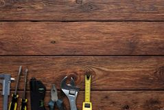 Free Different Tools And Tape-measure On Wood Background Stock Images - 113510884