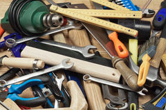 Different tools background. Set of different tools on a wooden planks Stock Photos