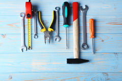 Different tools. On blue wooden table Stock Photos
