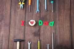 Different tools. For fathers day on brown wooden table Stock Photography