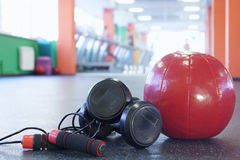 Different tools for fitness in gym. Dumbbells, skipping rope and ball for fitness in gym Stock Photos