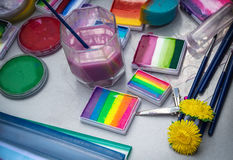 Different tools and paints for Aqua makeup and body art are on the table Royalty Free Stock Images
