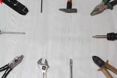 Different tools (pliers, hammer, wrench, nippers, screwdriver) on a wooden Royalty Free Stock Photos