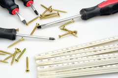 Different tools. Screwdriver, some wood screws and ruler royalty free stock photos