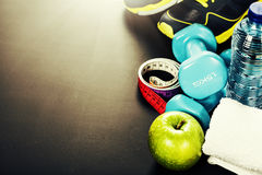 Different tools for sport. On grey background stock photography