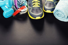 Different tools for sport. On grey background royalty free stock image