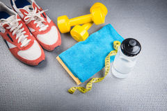 Different tools for sport. On grey background royalty free stock photography