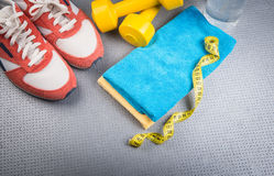 Different tools for sport. On grey background stock photo