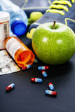 Different tools for sport and pills Royalty Free Stock Image