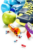 Different tools for sport and pills Stock Photography