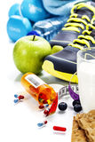 Different tools for sport and pills. (Vitamins or Fitness Supplement) on white background - sport, health and diet concept Stock Photo