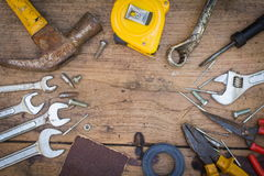 Different tools supplies on a wooden background Stock Image