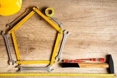 Different tools on a wooden background. Stock Images