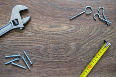 Different tools on a wooden background. Fathers day card. Royalty Free Stock Image