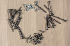 Different tools on a wooden background. Self-tapping screws Stock Photos