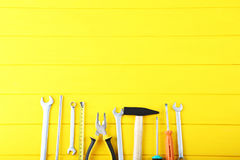 Different tools. On yellow wooden table Stock Images
