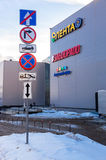 Different traffic signs near the modern largest shopping center Stock Image