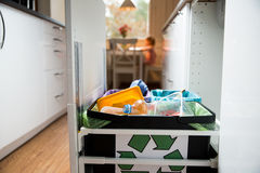 Different trash can with colorful garbage bags. Garbage cans. Three trash bins with sorted garbage in kitchen cabinet with segregated household garbage Stock Image