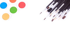 Different type of brushes and water color paints Stock Photography