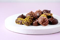 Different Type of Chocolate Candies on Pink Background Tasty Chocolate Candies Dessert Above Horizontal.  royalty free stock photos